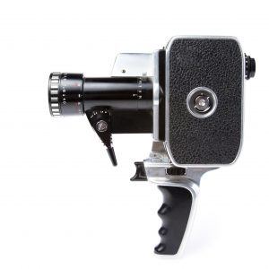 12360015 - photo of an 8mm film camera on white